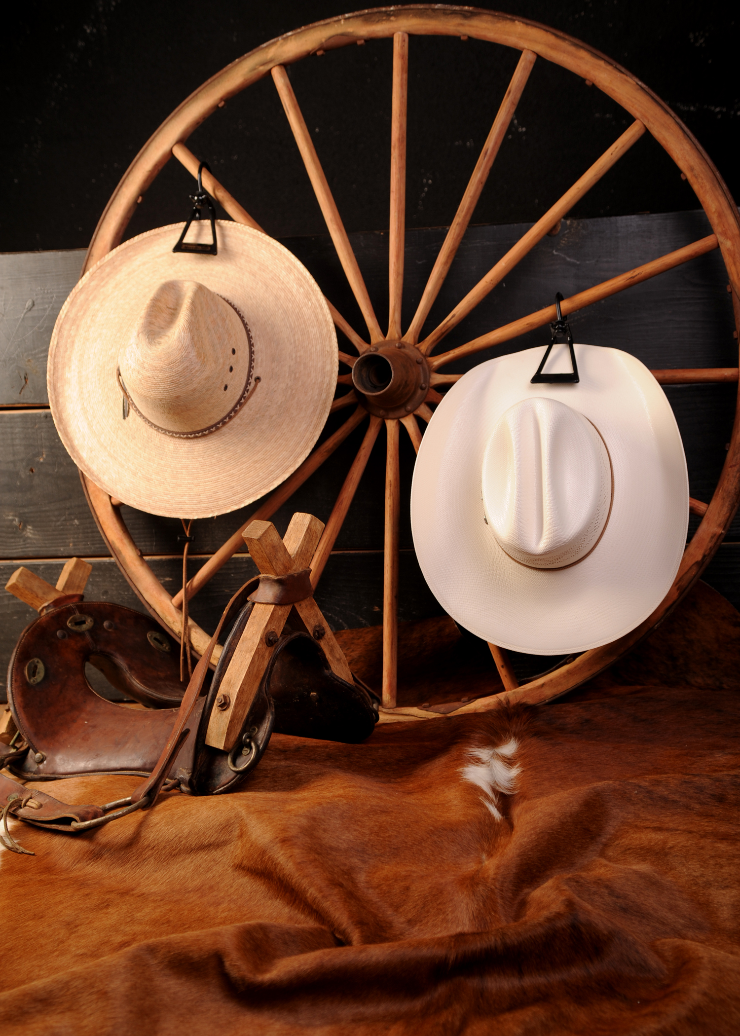 Hat hanger with hats on wagon wheel